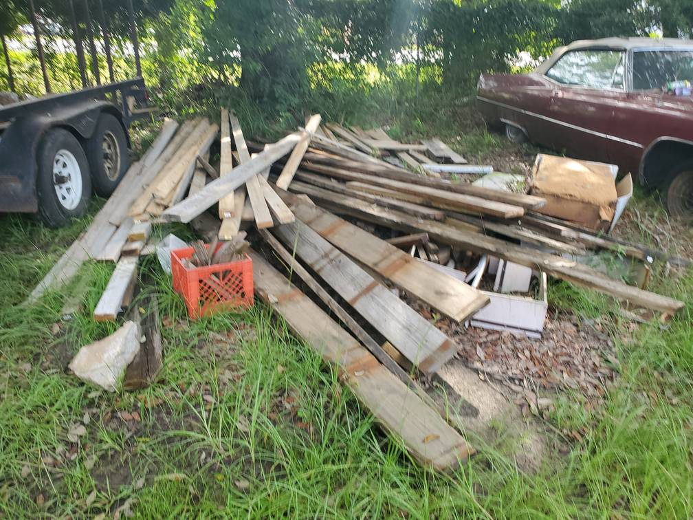 Pile Of Wood Outside Junk Removal Service Something Old Salvage 6505 North W Street Pensacola FL 32505 850 758 9900 www.somethingoldsalvage.com