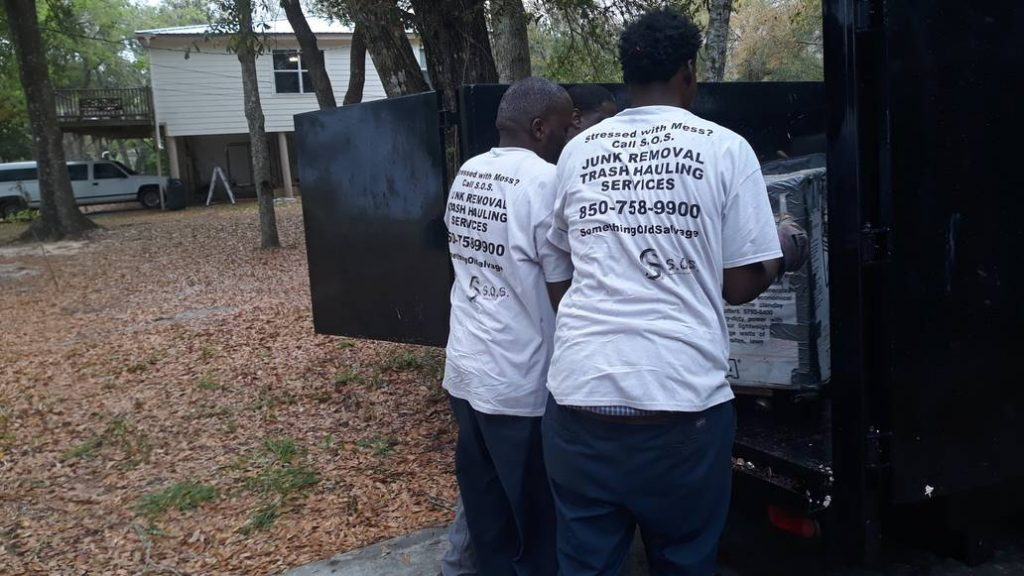 Two Men From Company Loading Junk Into Trailer - Junk Removal Service - Something Old Salvage - 6505 North W Street, Pensacola, FL 32505 - (850) 758 9900 - www.somethingoldsalvage.com